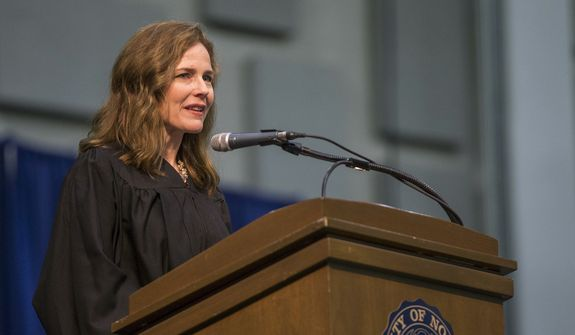 National and World News | Amy Coney Barrett, United States Court of Appeals for the Seventh Circuit judge, speaks during the University of Notre Dame's Law School commencement ceremony at the university, in South Bend, Ind. (Robert Franklin/South Bend Tribune via AP, File)