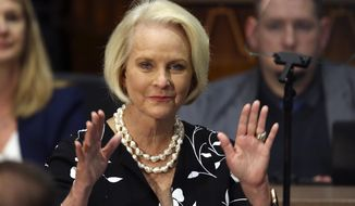 Cindy McCain, wife of former Arizona Sen. John McCain, waves to the crowd after being acknowledged by Arizona Republican Gov. Doug Ducey during his State of the State address. (AP Photo/Ross D. Franklin, File)