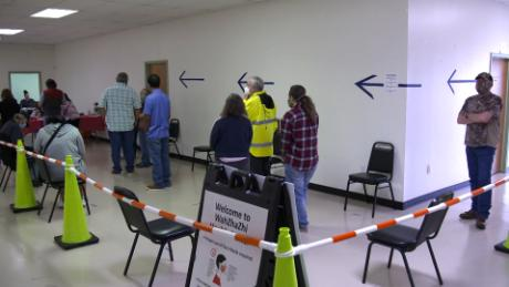 People form a line to get vaccines being given out by the Osage Nation