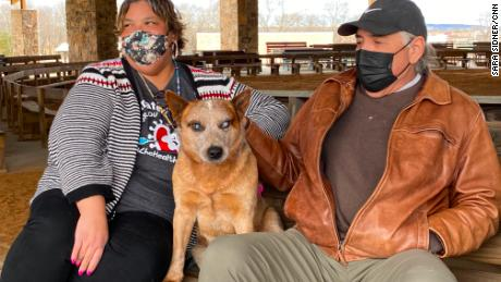Janese Sieke and Raymond Lasleysit with their blind dog Mick.