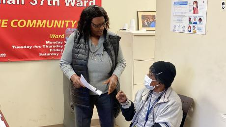 Alderman Emma Mitts, left, shares information about  her COVID vaccine experience. She also encourages her constituent, Bernice Hillman, 77, to get the vaccine.