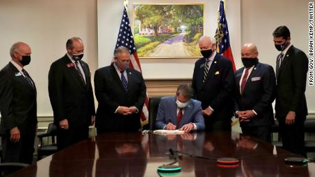 Gov. Brian Kemp signs Georgia's Election Integrity Act on March 25, 2021.