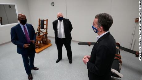 Gov. Ralph Northam, right, tours Greensville Correctional Center in Jarratt, Virginia, on March 24, 2021.
