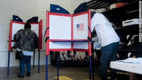Voters cast ballots for the 2020 Democratic Primary Election inside of a polling station at the Selma Fire Station on Super Tuesday in Selma, Alabama, last year.