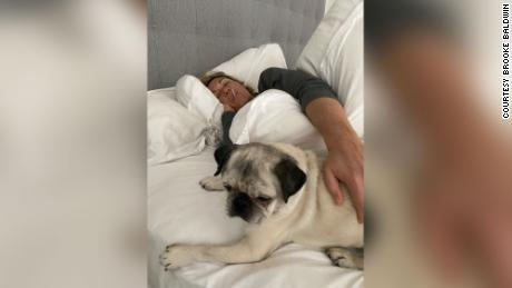 Brooke was stuck in bed because of Covid-19, fighting fevers, severe body aches and chills for 10 days. Her dog Pugsley often kept her company.