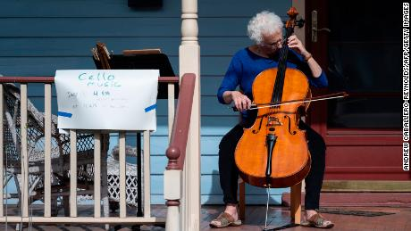 Cellist Jodi Beder plays on her front porch in Mount Rainier, Maryland. You can learn an instrument, too.