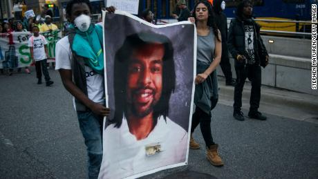 Protestors carry a portrait of Philando Castile on June 16, 2017, in St. Paul, Minnesota. The officer who shot and killed him was acquitted.