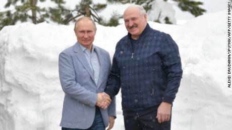 Russian President Vladimir Putin (L) shakes hands with Belarus President Alexander Lukashenko during their meeting in Sochi on February 22, 2021.