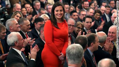 Rep. Elise Stefanik a New York Republican stands as she's acknowledged by then-President Donald Trump as he speaks one day after the Senate acquitted him on two articles of impeachment, at the White House in February 2020 in Washington, DC.