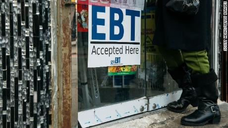A sign alerting customers about food stamps is displayed at a Brooklyn grocery store on December 5, 2019 in New York City.
