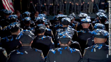 Confetti falls on the newest members of the New York City Police Department (NYPD) at the conclusion of their police academy graduation ceremony at the Theater at Madison Square Garden, October 15, 2018, in New York City.