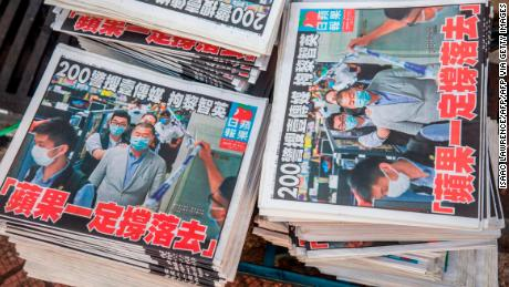 Hong Kong's biggest pro-democracy newspaper closes as Beijing tightens its grip