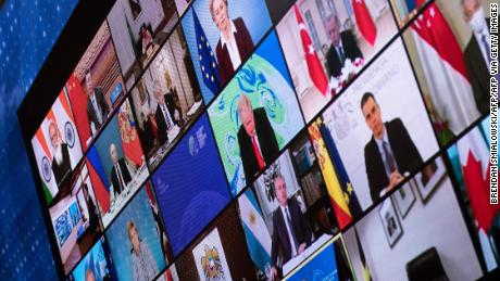 World leaders are seen on a screen during a climate change virtual summit from the East Room of the White House campus April 22, 2021, in Washington, DC