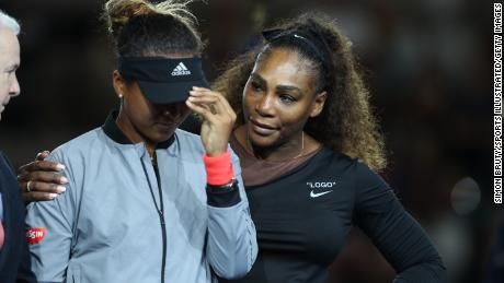 Osaka hid tears as the crowd booed her during her first US Open victory, while her opponent, Williams, comforted her.