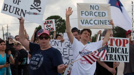 Employees protest against Houston hospital's policy that all staff must be vaccinated against Covid-19