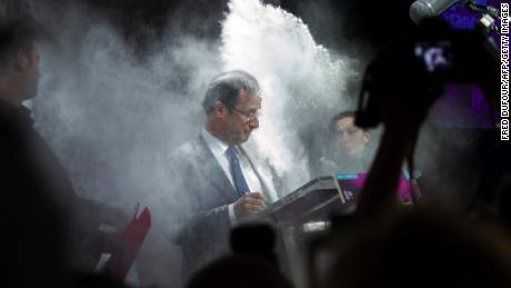 Hollande, floured by a woman on February 1, 2012 in Paris.