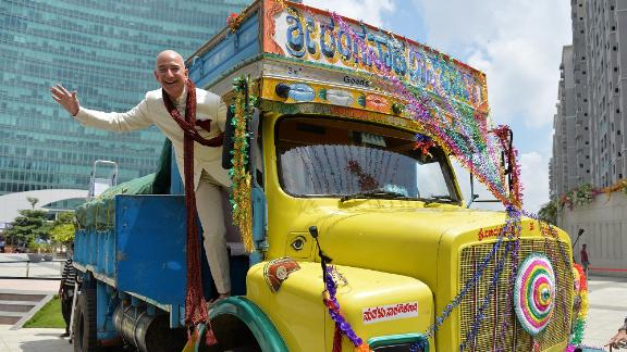 Bezos poses on a truck while visiting Bangalore, India, in 2014.