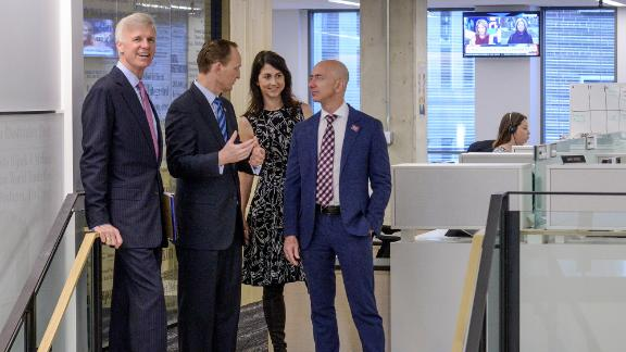 Bezos tours The Washington Post's new offices in 2016. Bezos bought the newspaper in 2013.