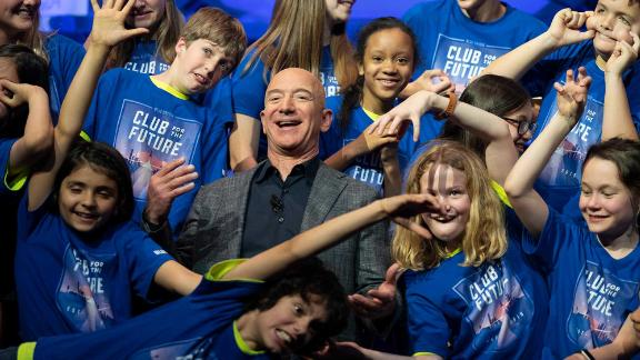 Bezos is joined by the children from the Blue Origin Club for the Future in 2019. At the event in Washington, DC, Bezos unveiled a Blue Origin prototype of a lunar lander.