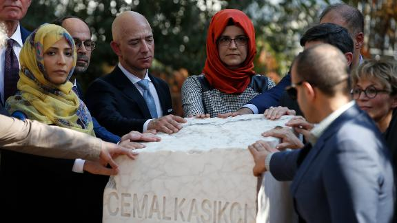 Bezos stands next to Hatice Cengiz, the fiancee of the late journalist Jamal Khashoggi, as a plaque is unveiled near the Saudi consulate in Istanbul in 2019. It was a year after Khashoggi, a Washington Post columnist, was killed.