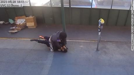 Bystanders helped a San Francisco police officer as she was being attacked