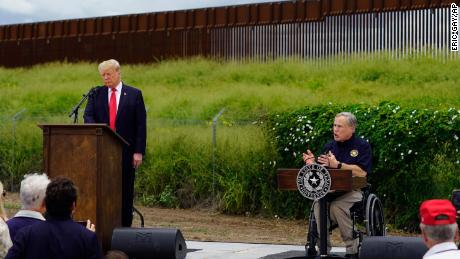 Former President Donald Trump and Texas Gov. Greg Abbott visit an unfinished section of border wall in Pharr, Texas, on June 30.