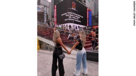 The Cavinder twins admiring their names on an electronic billboard in New York City.