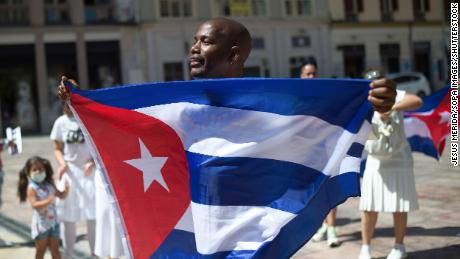 A man seen holding a Cuban flag as he takes part in a protest this week in support of the Cuban population at Plaza de la Constitution square in Malaga, Spain.