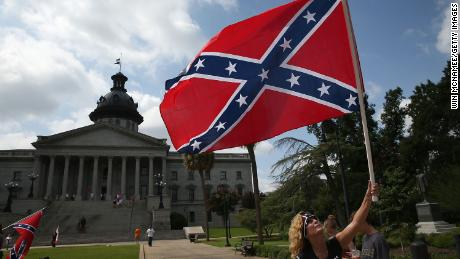 Barbie Byrd, of Columbia, South Carolina joins a group of demonstrators on the grounds of the South Carolina State House calling for the Confederate flag to remain on the State House grounds.