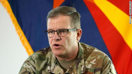 In this May 20, 2020, file photo, then-Arizona National Guard Maj. Gen. Michael McGuire, director of the Department of Emergency and Military Affairs, answers a question at a news conference in Phoenix.