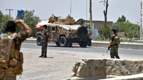 Afghan security personnel stand guard during fighting between Afghan security forces and Taliban fighters in Kandahar on July 9.