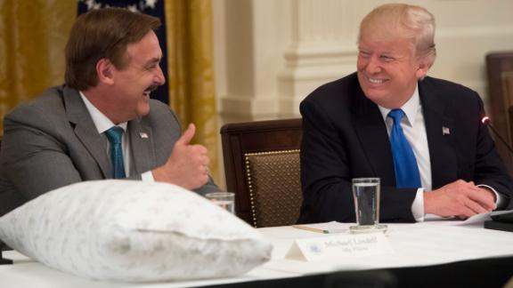 """President Donald Trump speaks alongside MyPillow CEO Mike Lindell, during a """"Made in America"""" event with US manufacturers at the White House on July 19, 2017."""