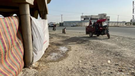 An unfinished construction site is now the site of an informal camp housing around 30 families who have fled the violence. A tuk-tuk delivers new arrivals.