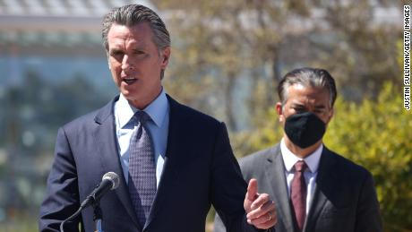 California Gov. Gavin Newsom speaks as California Attorney General Rob Bonta, at right, looks on during a news conference at San Francisco General Hospital on June 10.