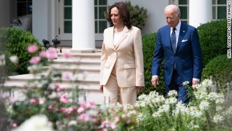 US President Joe Biden and US Vice President Kamala Harris (L) arrive for a ceremony commemorating the 31st anniversary of the Americans with Disabilities Act (ADA), in the Rose Garden of the White House in Washington, DC, on July 26, 2021.