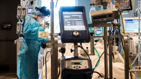 Nichole Arevalo, an R.N. at the downtown campus of NCH in Naples, Florida, treats a Covid-19 patient in the Intensive Care Unit on August 9, 2021.