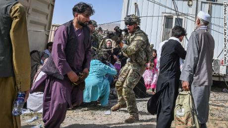 Afghans watch nervously as Taliban regime takes shape, and US and its allies continue frantic exit