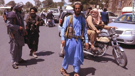 Taliban fighters patrol the streets in Herat on August 14.