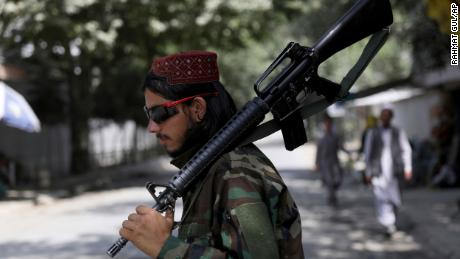 A Taliban fighter stands guard at a checkpoint in the Wazir Akbar Khan neighborhood in the city of Kabul, Afghanistan, Sunday, Aug. 22, 2021.