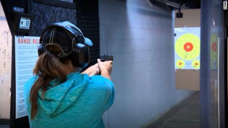 A woman fires a gun at a shooting range. CDC Director Dr. Rochelle Walensky wants to work with gun owners to investigate ways to prevent gun injuries and deaths.