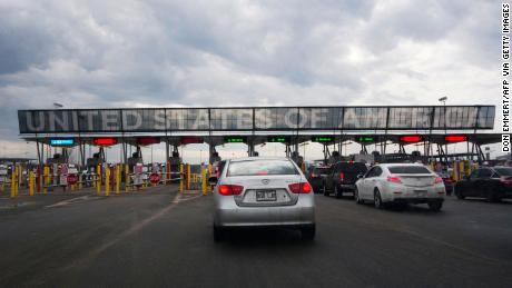 US extends travel restrictions at Mexican and Canadian land borders as it makes plans to allow fully vaccinated foreign visitors to fly to America
