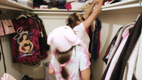 Juana and her youngest daughter Casandra used to pick clothes out over the phone. Now, they do it together.