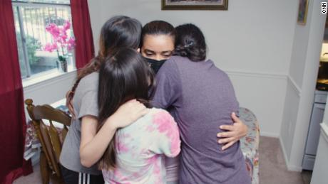 Juana hugs three of her daughters, about a month after they were reunited in the United States.
