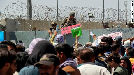 Thousands of Afghans gathered outside Kabul airport while US evacuations were ongoing, desperate for a flight out of the country.