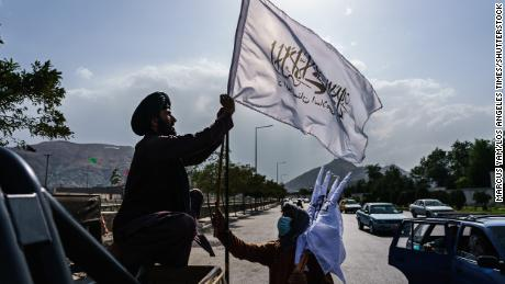 A boy selling Taliban flags in Kabul. Most of the country does not remember the previous era of Taliban rule, which ended in 2001.