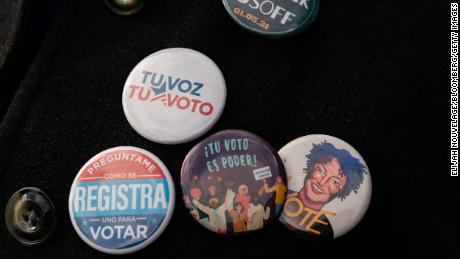 An attendee wears Spanish-language buttons during a campaign event for Democratic Senate candidate Jon Ossoff in Lilburn, Georgia, on December 7, 2020.