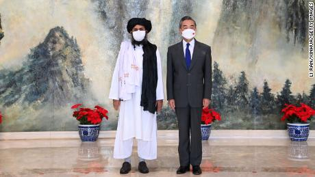 Chinese Foreign Minister Wang Yi meets with Mullah Abdul Ghani Baradar, the Taliban's political chief, in Tianjin, northern China on July 28.