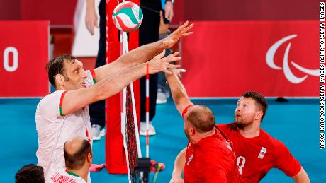 Mehrzad competes at the net against the RPC's Viktor Milenin during the men's sitting volleyball final.