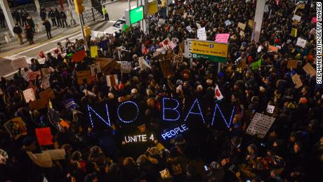 Protesters rally during a demonstration against the travel ban targeting predominantly Muslim countries, January 2017, New York City.