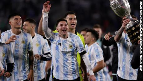 Messi and Argentina celebrate with the Copa América trophy in front of fans in Buenos Aires.